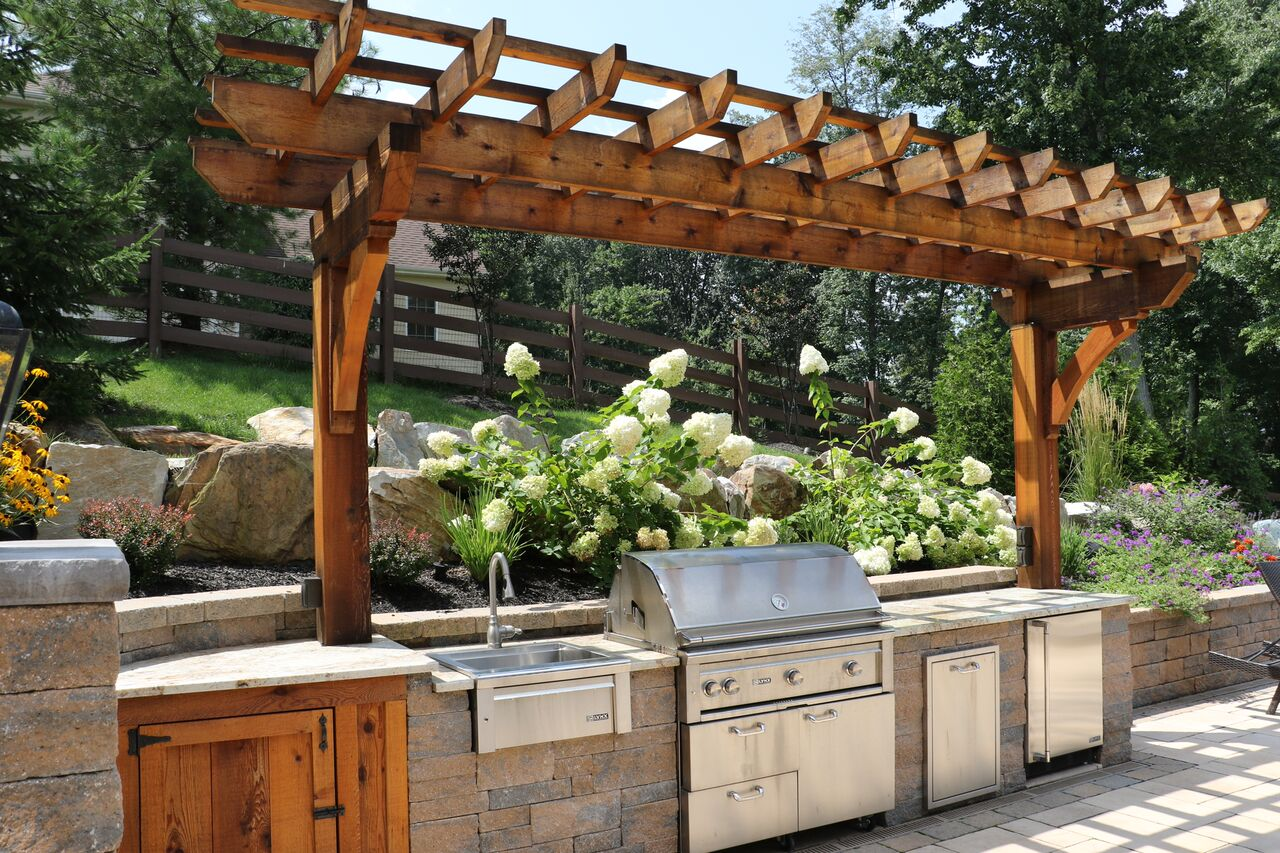 wooden pergola that blends with kitchen cabinet underneath